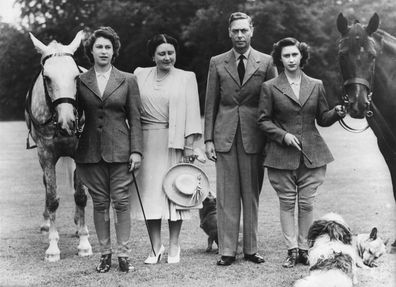 The two princesses, Elizabeth, left, and Margaret Rose, right, pose with Their Majesties, Queen Elizabeth and King George VI, before setting off on their daily canter at Windsor Castle in 1946.