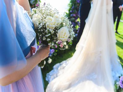 Maid of honour standing next to bride at wedding