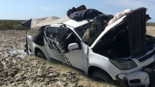 The men were forced to sleep on the roof of their bogged Holden Colorado. (Supplied)