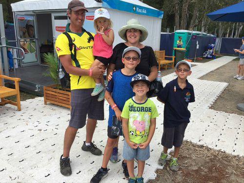 The Lockhart family from Tasmania, including dad Greg, Aamirah, two, mum Kim, Jamari, 10, Jerrah, eight, and Zimram, five, enjoying the mountain bike cross country final. (9NEWS/Darren Curtis)