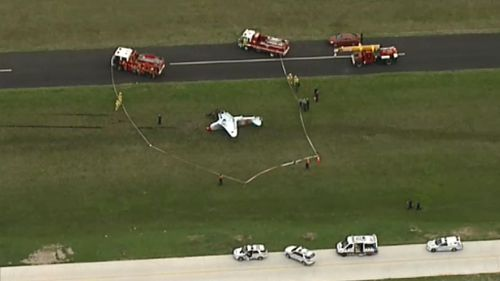 Investigators believe the plane flipped when the plane's wheels got caught in soft grass. (9NEWS)