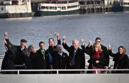 """Captain Chesley """"Sully"""" Sullenberger III (fourth from right) joins survivors and rescuers in a toast marking the fifth anniversary of the miracle landing."""