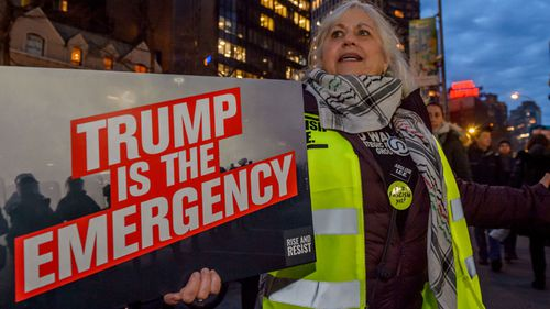 Activist group Rise And Resist in New York City demonstrate at the Trump Hotel.