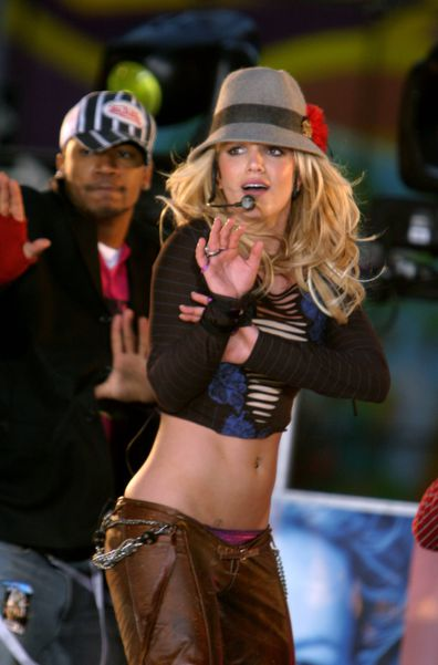 Britney Spears and Columbus Short perform on MTV's TRL in November 2003.