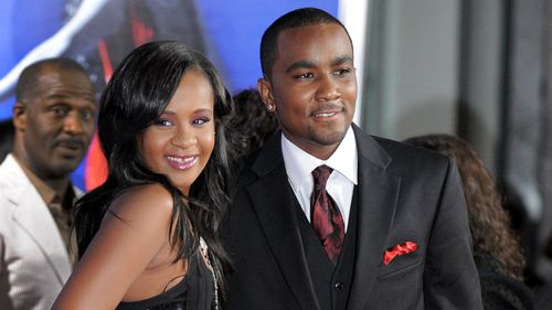 Brown with partner Nick Gordon. (AAP)