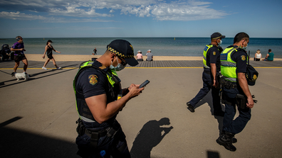 Public Service Officers patrol at St Kilda beach on October 03, 2020 in Melbourne, Australia. Coronavirus restrictions eased slightly across Melbourne from Monday 28 September as Victoria enters into its second step in the government's roadmap to reopening. (Photo by Darrian Traynor)