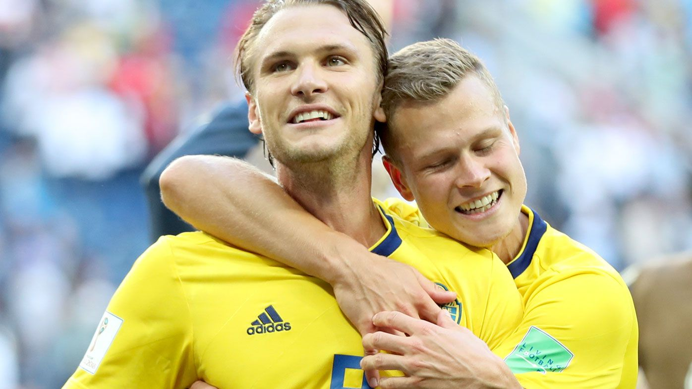 Albin Ekdal and Viktor Claesson celebrate Sweden's victory over Switzerland. (AAP)