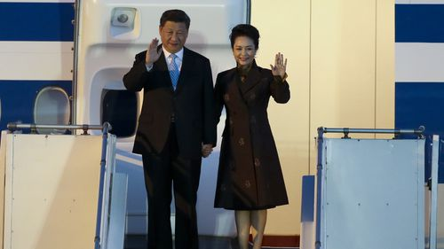 China's President Xi Jinping and first lady Peng Liyuan arrive at the Ministro Pistarini international airport in Buenos Aires.