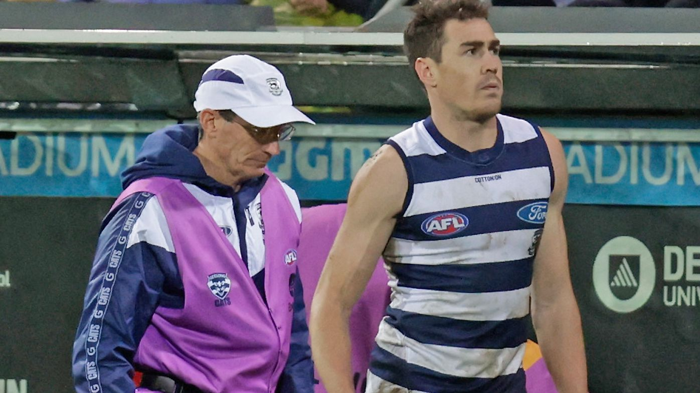 Jeremy Cameron of the Cats speaks with medical staff