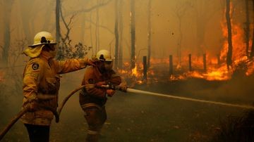 Rural Fire crews battle an out of control fire near houses along Lemon Tree Passage Road, in Salt Ash, NSW, Friday, November 23, 2018.