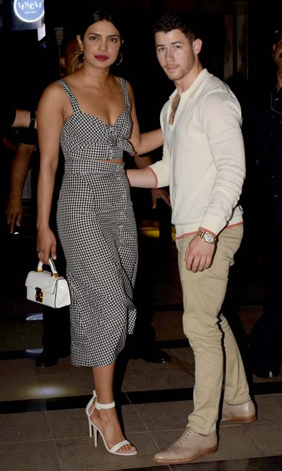 """<p>Actress Priyanka Chopra and musician Nick Jonas may be <a href=""""https://thefix.nine.com.au/2018/06/04/16/55/nick-jonas-priyanka-chopra-dating"""" target=""""_blank"""" draggable=""""false"""">Hollywood's newest power pair</a> but they have already mastered the art of high-voltage couple dressing.</p> <p>The duo, who officially became <a href=""""https://www.instagram.com/nickjonas/?hl=encm"""" target=""""_blank"""" draggable=""""false"""">'Instagram official'</a>in June, ticked off another milestone by way of coordinated date night attire.</p> <p>For an appearance in Mumbai, India, the Quantico actress donned a two-piece gingham ensemble from New York label, A.L.C. Paired with a pair of white sandals and matching tote, the look was summery, soft and feminine.</p> <p>Meanwhile, the youngest Jonas brother complemented her look in an equally fresh outfit consisting of a white Henley shirt, khaki chinos, and brown oxfords.</p> <p>Considering their joint fashion credentials, it's no surprise that ' Jopra' are already giving<a href=""""https://style.nine.com.au/2017/07/05/13/00/style_david-and-victoria-beckham-style-evolution"""" target=""""_blank"""" draggable=""""false""""> the Beckhams,</a> <a href=""""https://style.nine.com.au/2018/06/22/09/11/louis-vuitton-menswear-spring-summer-19"""" target=""""_parent"""" draggable=""""false"""">Kimye,</a> Blake and Ryan and<a href=""""https://style.nine.com.au/2018/01/29/09/09/jay-z-beyonce-grammy-awards-outfits-fashion"""" target=""""_blank"""" draggable=""""false""""> the Carters</a> are run for their money in the joint style stakes.</p> <p>Chopra's glamorous and elegant aesthetic has seen her land on the covers of International editions of <em>Vogue</em>, <em>Elle</em> and<em> Harper's Bazaar. </em></p> <p>While Jonas has come a long way since his days of purity rings and pop songs having launched <a href=""""https://style.nine.com.au/2018/01/23/10/01/nick-jonas-john-varatos-mens-fashion-label"""" target=""""_blank"""" draggable=""""false"""">a fashion collection with American menswear designer John Varvatos</a>, earlier this """