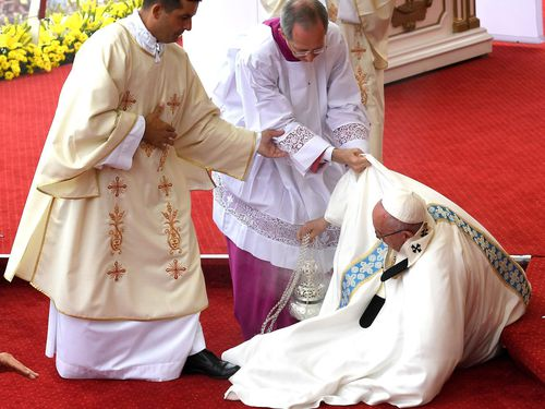 Pope Francis falls during mass in Poland. (AAP)