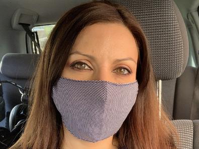 Jo Abi wearing a fabric face mask in public.