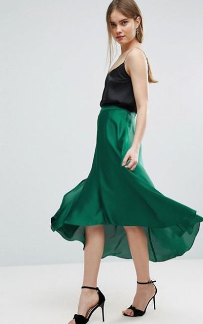 """<a href=""""http://www.asos.com/au/asos/asos-midi-skirt-in-satin-with-splices/prd/7323233?&amp;channelref=product+search&amp;affid=11148&amp;ppcadref=870174879%7C44678211555%7Cpla-305575563246&amp;gclid=EAIaIQobChMI6du8uNTs2AIVE3y9Ch35pgFnEAkYBiABEgIERvD_BwE&amp;gclsrc=aw.ds"""" target=""""_blank"""" draggable=""""false"""">ASOS Midi skirt with satin splices</a>, $70"""