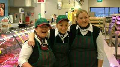 Three employees of Woolworths Camperdown pose in front of the deli in 2003. (Supplied)