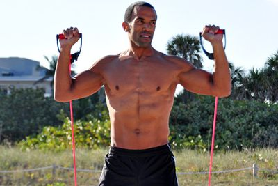 Craig took the break as a chance to work on his six-pack. He's pumping iron on Miami Beach.