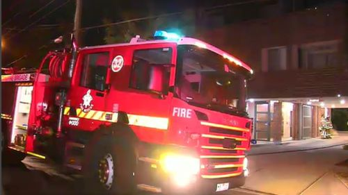 PSOs called in emergency services after they were unable to free the man in the smoke-filled apartment. (9NEWS)