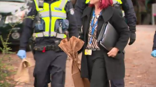 Detectives seized a number of objects from the scene this afternoon, including what appeared to be a metal pole. (9NEWS)