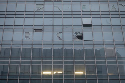 Broken window panels in One Finance Centre building in Hong Kong.