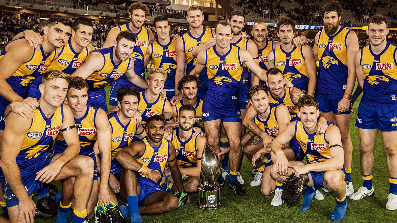 The Eagles pose for a team picture after winning the Derby