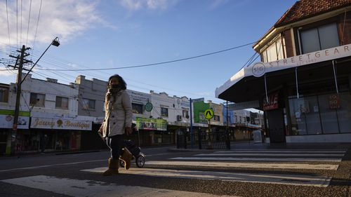 A pedestrian is seen in the suburb of Lakemba in Sydney.