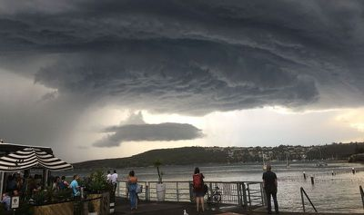 A huge storm front gathered ominously over Manly yesterday afternoon.