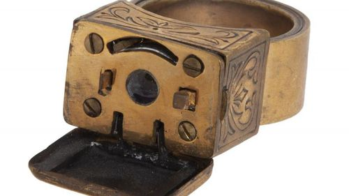 A Soviet KGB spy miniature camera designed to look like a ring.