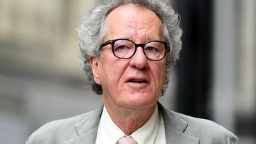 Australian actor Geoffrey Rush arrives at the Federal Court in Sydney.