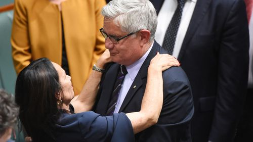 Linda Burney and Ken Wyatt embrace after her maiden speech to parliament in 2016.