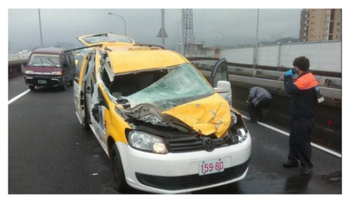 The taxi that was hit by the plane as it crashed into the river. The driver has been taken to hospital and is in a stable condition (Twitter).