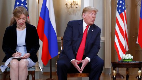 "Mr Trump has complained some people ""HATE"" the fact that he ""got along well"" with Russian President Vladimir Putin, preferring to ""go to war than see this"". Image: AP"