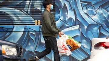 A man is seen wearing a face mask to protect himself from coronavirus in Melbourne.