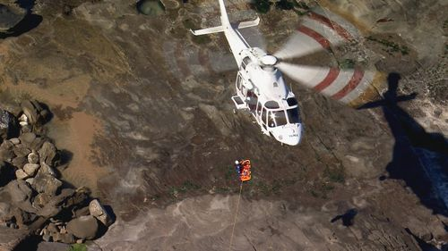 A woman has been rescued after being swept onto the rocks at Stanwell Park.