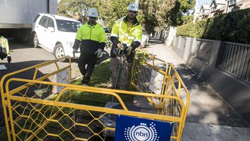 Contractors install NBN infrastructure in Sydney.