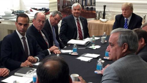 George Papadopoulos (left) in a meeting with now-President Donald Trump.