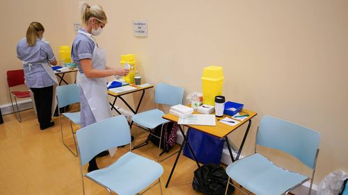 Medical vaccination staff prepare to receive young patients in Newcastle, England.