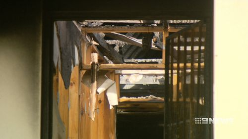 The fire caused the home's roof to collapse. (9NEWS)