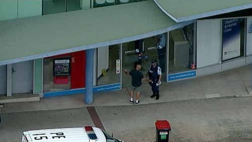 A man was arrested after claiming to have a gun. (9NEWS)