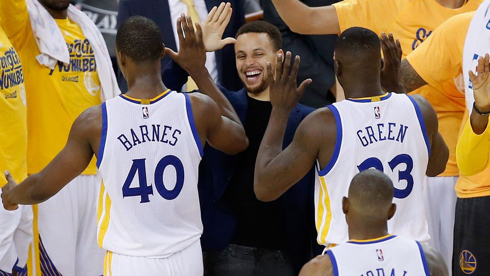 Steph Curry high fives Warriors teammates after their playoffs win over Portland. (Getty)