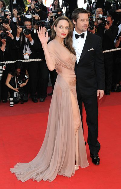 Angelina Jolie in Versace and Brad Pitt at the <em>Inglourious Bastards</em> premiere in Cannes in May, 2009&nbsp;