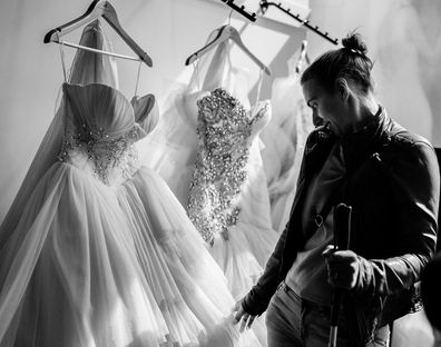 Steph browses dresses, by touching them.