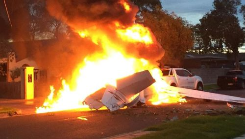 The plane erupted in flames after crashing onto the road. Picture: 9NEWS