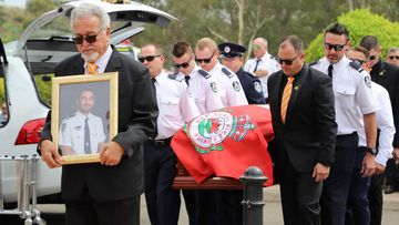His coffin was draped in a bright red RFS flag.