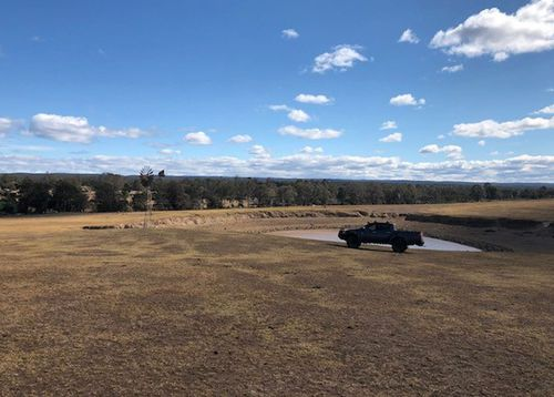 Farmer Brett Hayter's land is stricken by drought in Wollondilly, an hour out of Sydney.