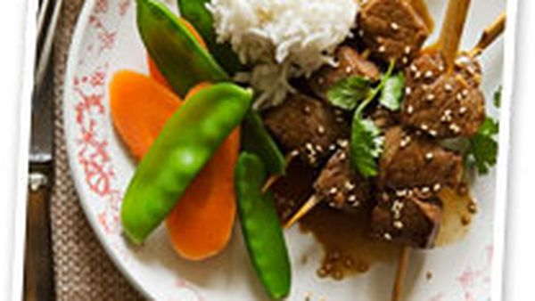 Teriyaki beef skewers with steamed rice