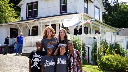 """Devonte Hart with his family at the annual celebration of """"The Goonies"""" movie in Astoria, Oregon. (AP)"""