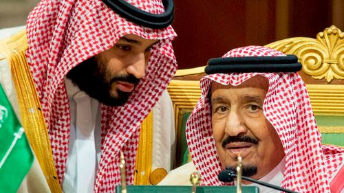 A file photograph shows Saudi Crown Prince Mohammed bin Salman speaking to his father, King Salman in Riyadh.
