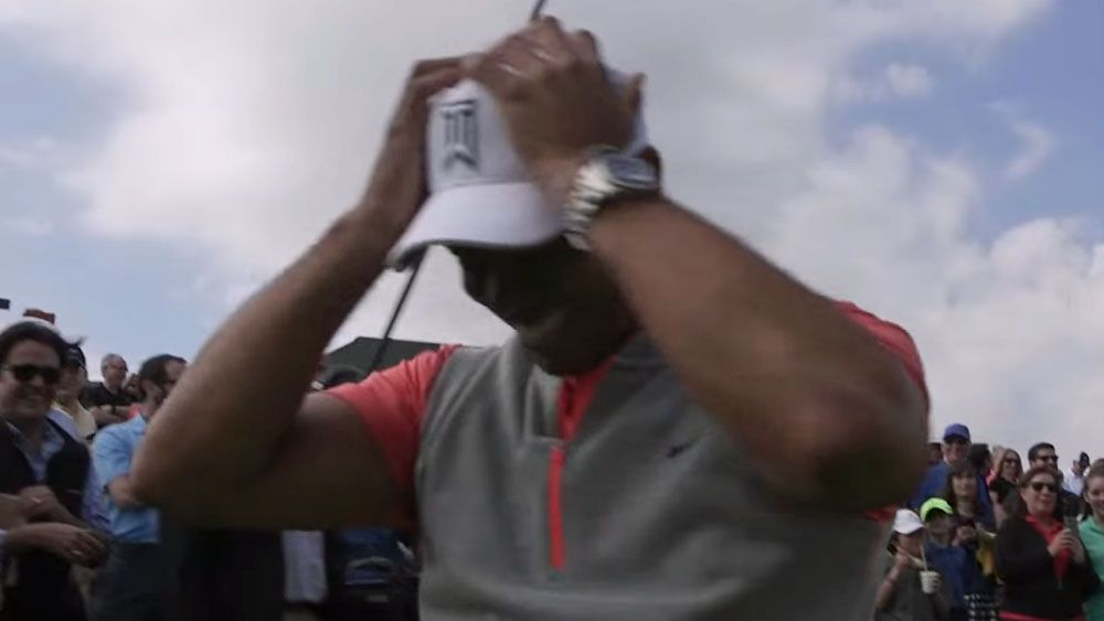 Woods humbled by young rival's hole-in-one