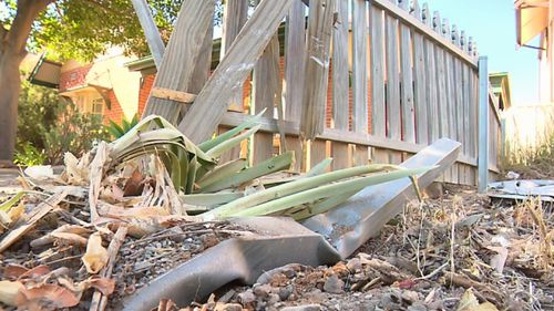 The car had crashed into the fence of a home.