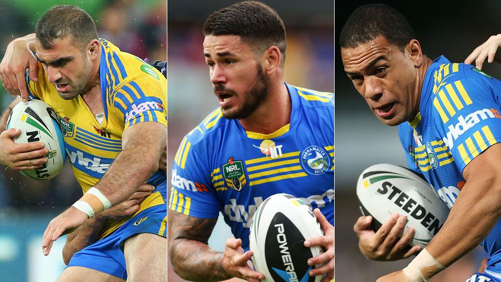 Tim Mannah, Nathan Peats and Will Hopoate. (Getty)